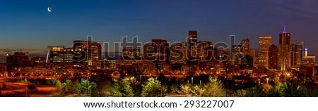 Denver Colorado skyline at night with moon - stock photo