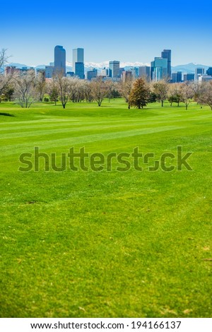 Denver Colorado USA. Spring Time in Colorado. Denver Skyline and Green Fields.  - stock photo
