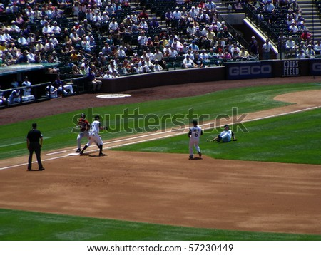 DENVER - JUNE 29: Byung-Hyun Kim, the Rockies pitcher, slips and falls as he tries to make the play at first base in a game at Coors Field against the Houston Astros June 29, 2005 in Denver, Colorado - stock photo