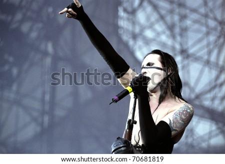 DENVER - JUNE 22: Performer Marilyn Manson entertains live in concert June 22, 2001 at Mile High Stadium in Denver, CO. - stock photo