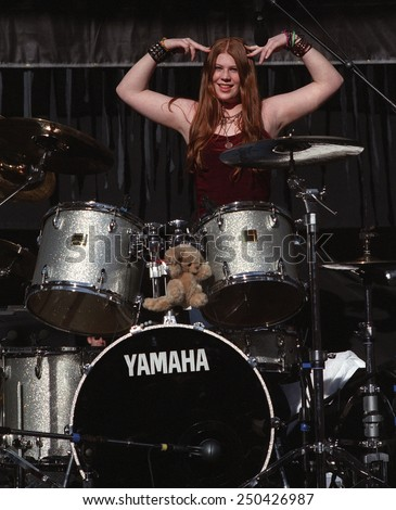 DENVERMAY 01:Drummer Mercedes Lander of the Alternative Rock band Kittie performs in concert May 11, 2001 at Red Rocks Amphitheater in Denver, CO.  - stock photo