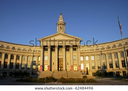 Denver's historic city and county building in morning sun light - stock photo