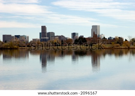Denver's skyline with Sloan's lake in foreground on a beautiful calm autumn day. - stock photo