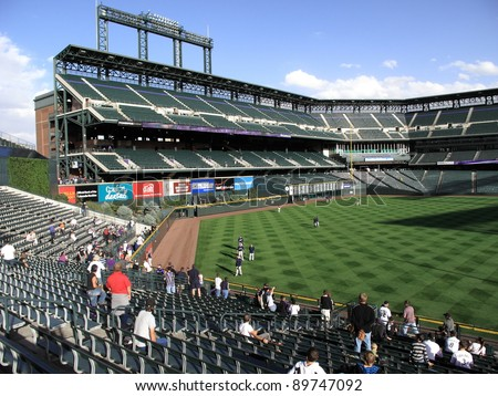 DENVER - SEPTEMBER 30: Practice before a baseball game at Coors Field, home of the Rockies, on September 30, 2009 in Denver, Colorado. Opened in 1995, it seats 50,490 fans and cost $300 million. - stock photo