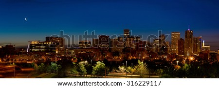 Denver skyline night with crescent moon - stock photo