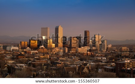 Denver Winter Skyline With Rocky Mountains at Sunrise - stock photo