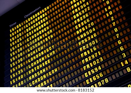 Departure board at Dublin International Airport (DUB) - stock photo
