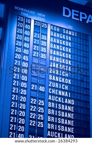 Departure schedule board in asian airport - stock photo