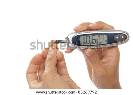 Dependent first type Diabetes patient measuring glucose level blood test using ultra mini glucometer and small drop of blood from finger and test strips isolated on a white background - stock photo