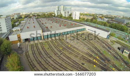 Depot with many railways at day in city at cloudy day. View from unmanned quadrocopter. - stock photo