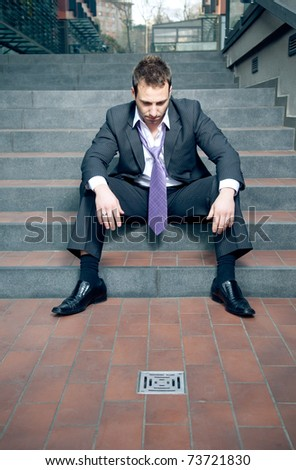 Depressed businessman. All went down the drain concept. - stock photo