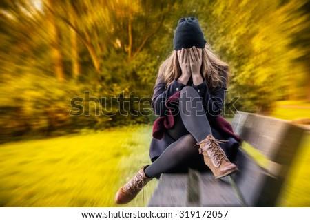 depressed female in autumn season - stock photo