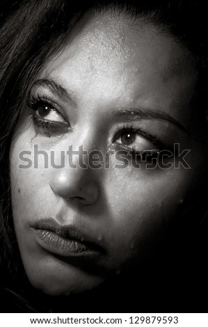 Depressed girl in tears with bad make-up concept in monochrome - stock photo
