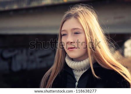 Depressed girl outdoor. - stock photo