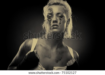 Depressed girl with dirt on her face, closeup. Studio shot, sepia - stock photo