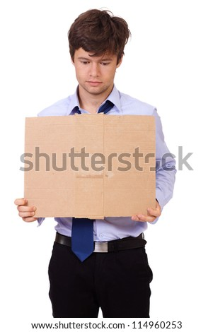 Depressed jobless and homeless young businessman holding a cardboard, isolated on white background - stock photo