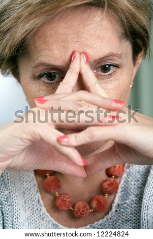 Depressed middle-aged woman - stock photo