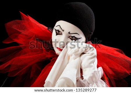 Depressed Pierrot crying in a white handkerchief - stock photo