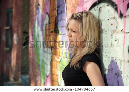 Depressed teenager facing her own problems outdoor - stock photo