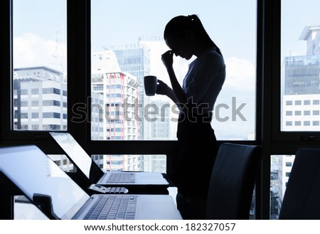 Depressed woman in the office - stock photo
