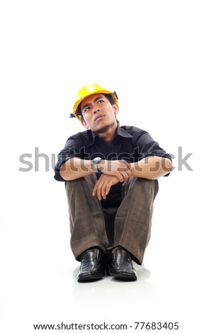 Depressed workers sit silently and looking up think isolated white background - stock photo