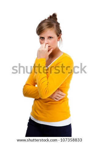 Depressed young attractive woman isolated on white - stock photo
