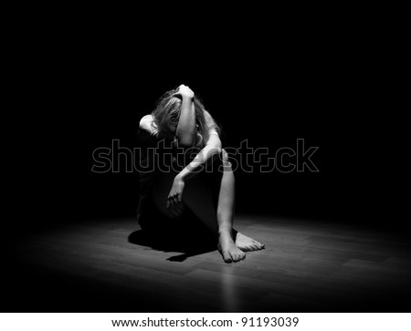 Depressed young lonely woman - stock photo