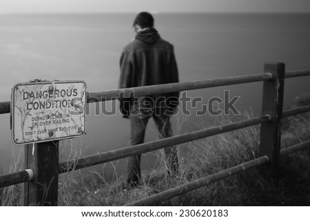 Depressed young man. Suicide concept - stock photo
