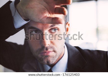 Depressed young professional looking away - stock photo