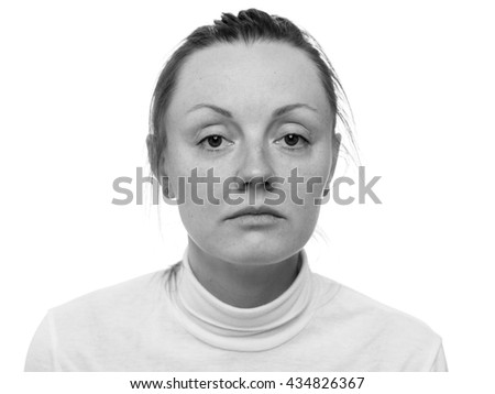 Depression. Close up portrait of a sad woman looking to the camera, isolated on white background,  black and white - stock photo