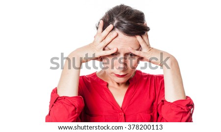 depression concept - concerned young woman suffering from a headache, seeking for inspiration or feeling desperate, white background studio - stock photo