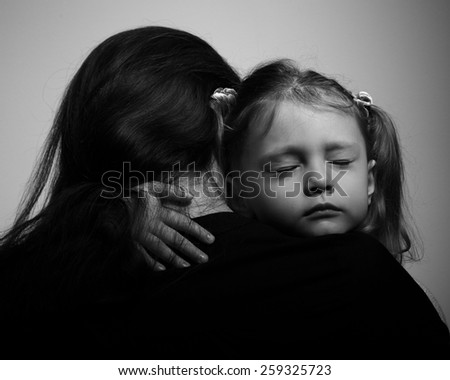 Depression daughter hugging her mother with sad face. Closeup portrait black and white - stock photo