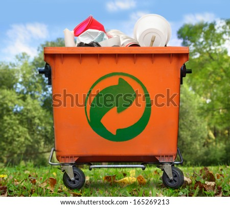 Der Grune Punkt on garbage bin - stock photo