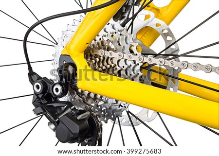 derailleur mechanism closeup on a yellow mountain bike isolated on white background - stock photo