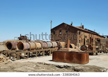Derelict and rusting administrative buildings at the historic Humberstone Saltpeter Works in the Atacama Desert near Iquique in Chile. The site is now a museum and a Unesco World Heritage SIte. - stock photo