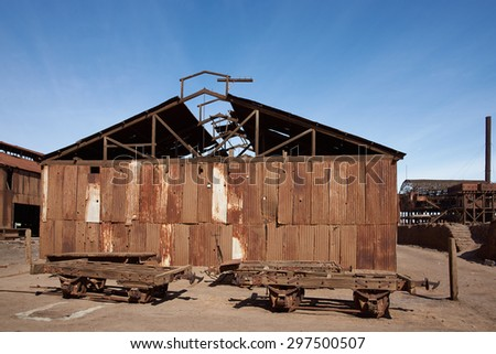 Derelict and rusting buildings at the historic Santa Laura Saltpeter Works in the Atacama Desert near Iquique in Chile. The site is now an open air museum and a Unesco World Heritage SIte. - stock photo