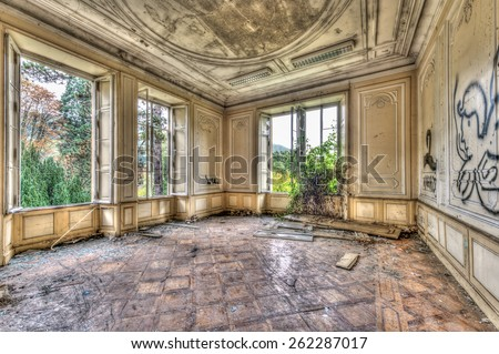Derelict luxurious room in an abandoned manor, HDR - stock photo