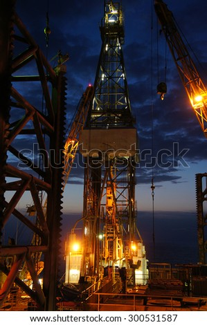 Derrick of Jack Up Drilling Rig (Oil Rig) at Twilight Time - stock photo