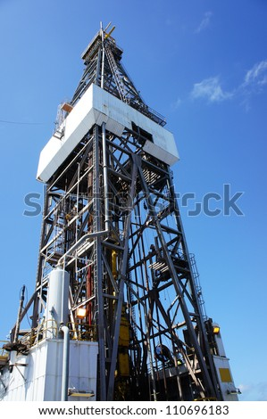 Derrick of Offshore Jack Up Drilling Oil Rig with Blue Sky - stock photo