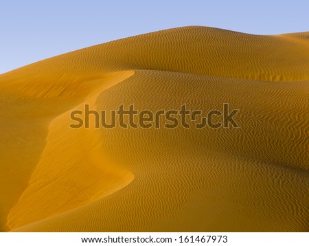 Desert, Abu Dhabi - changing patterns of the Liwa Desert, which is part of the Rub al Khali Desert or Empty Quarter, straddling UAE, Oman, Yemen and Saudi Arabia - stock photo