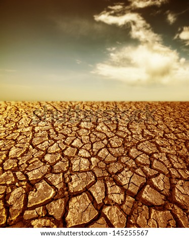 desert - cracked dried soil and sky - stock photo