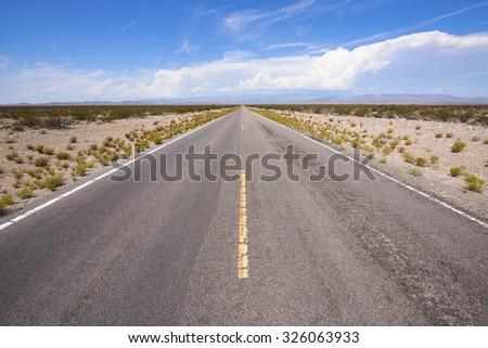 Desert highway in Mojave desert, California. - stock photo