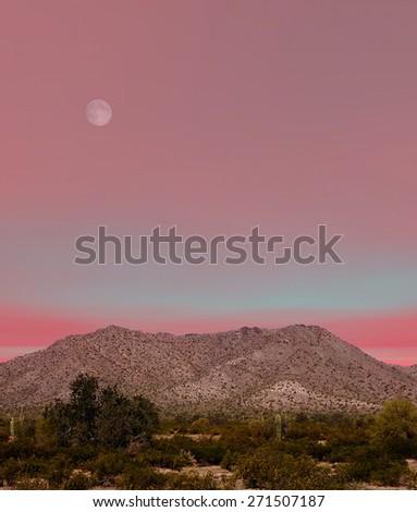 Desert moon over the southwestern USA Sonora desert and mountains - stock photo