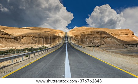 Desert road before thunderstorm - stock photo