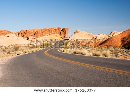 Desert road through sandstone Valley of Fire State Park - stock photo