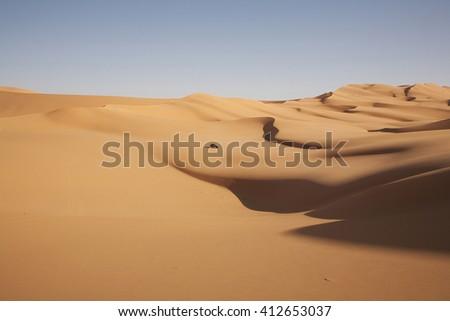Desert Sahara with car - stock photo