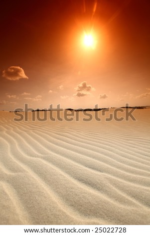 desert sand under blue sunny sky - stock photo