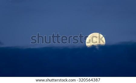 Desert sky at night with setting full moon, Tucson, Arizona - stock photo