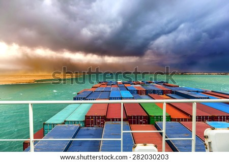 Desert Storm in SUEZ CANAL, Egypt. Container cargo ships going through the canal.  - stock photo