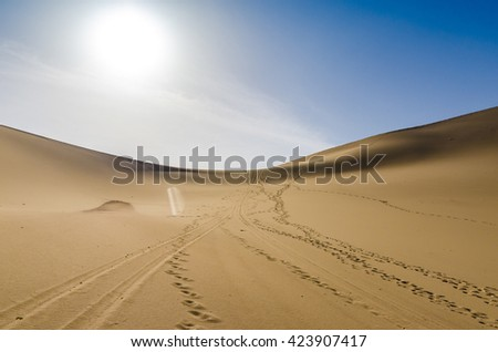 desert under blue sky with foot print - stock photo